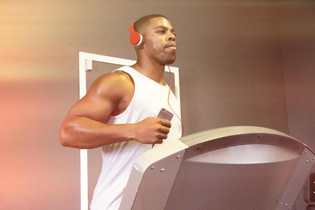 beginner runner on treadmill with headphones