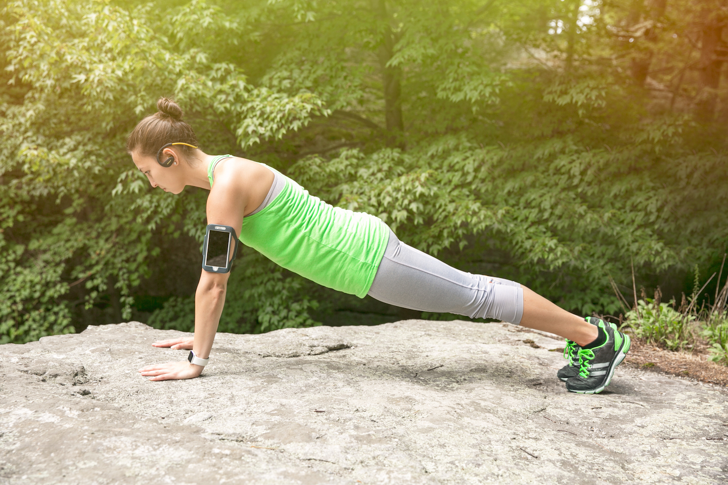 fitness woman performs core workouts