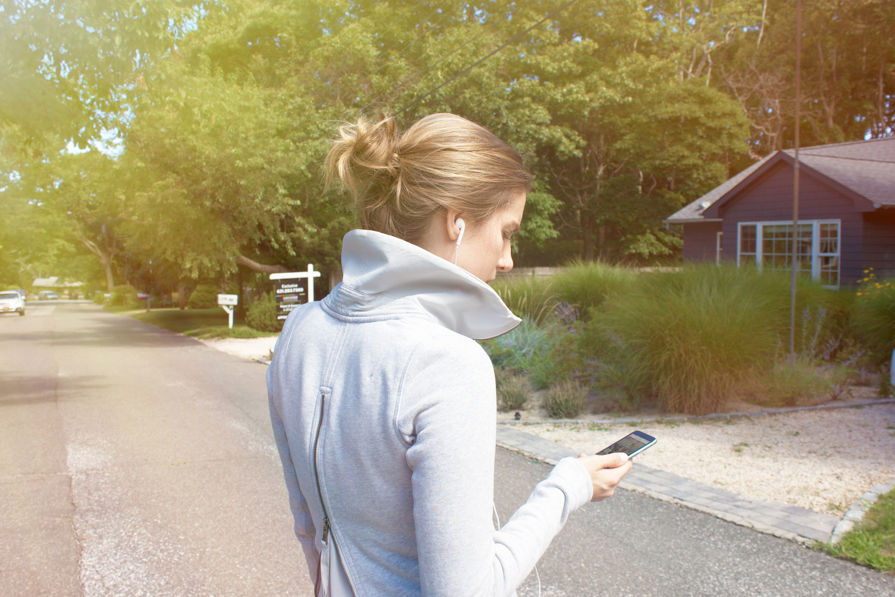 woman listening to music on fall workout
