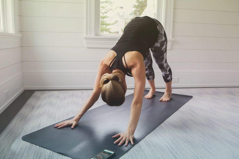 pregnant woman doing hot yoga