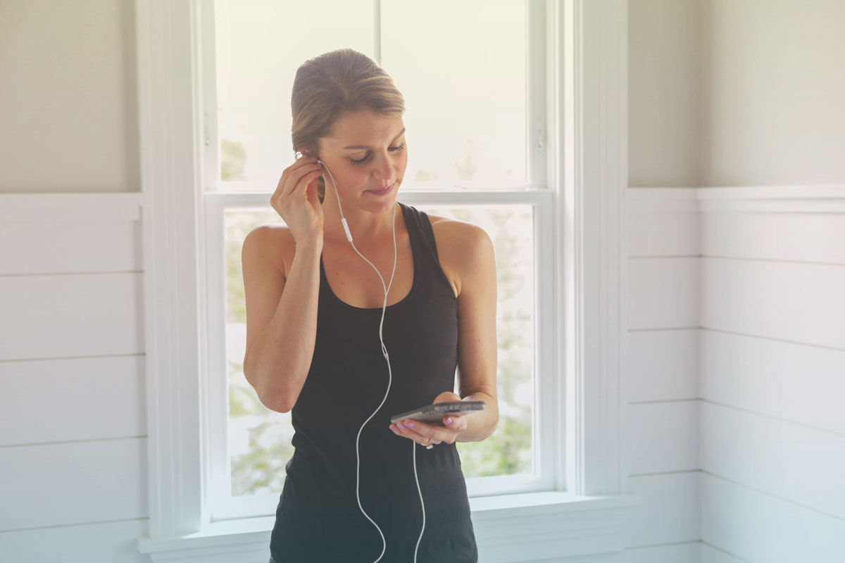 pregnant woman putting in ear phones