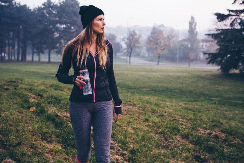 woman doing walking workouts in a field