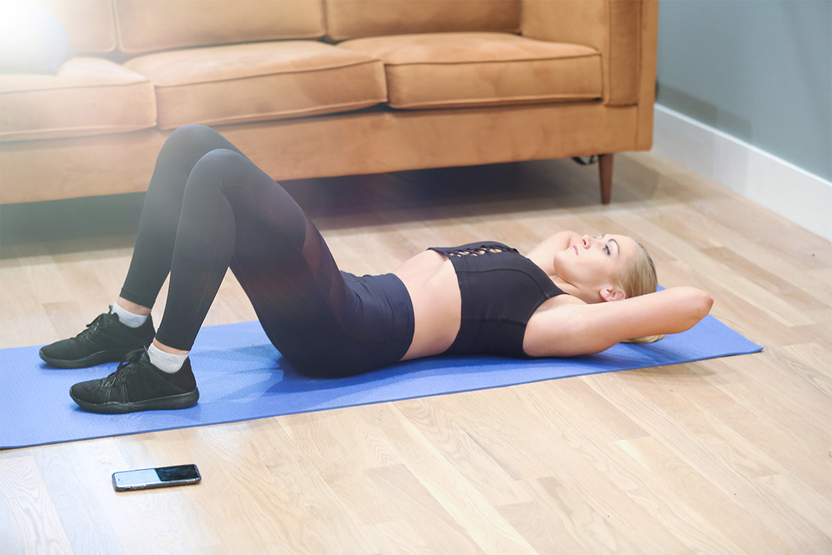 woman doing ab workouts at home