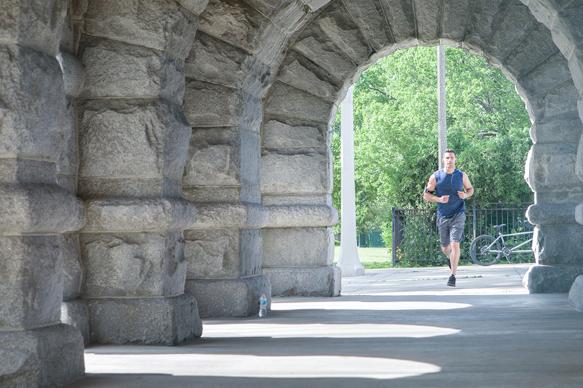 Man running in a park to chisel your abs