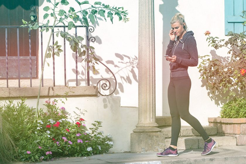 woman with headphones make time for fitness