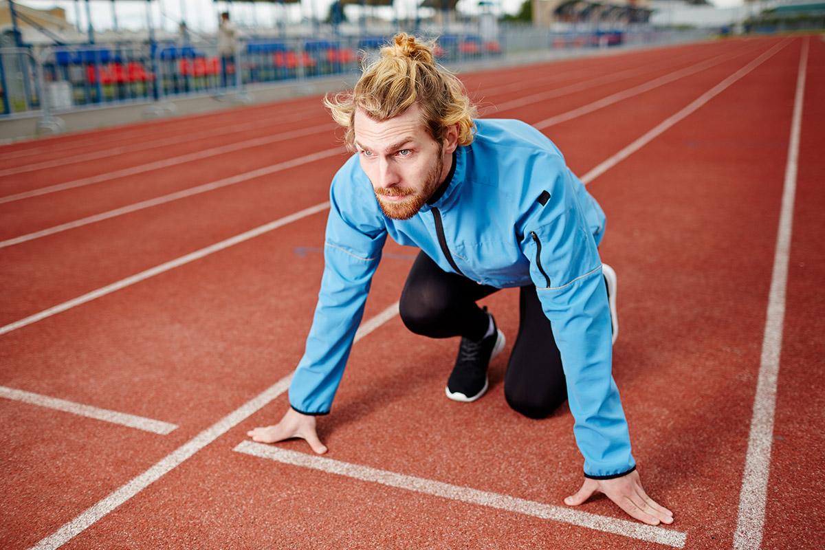 man outdoor running on track