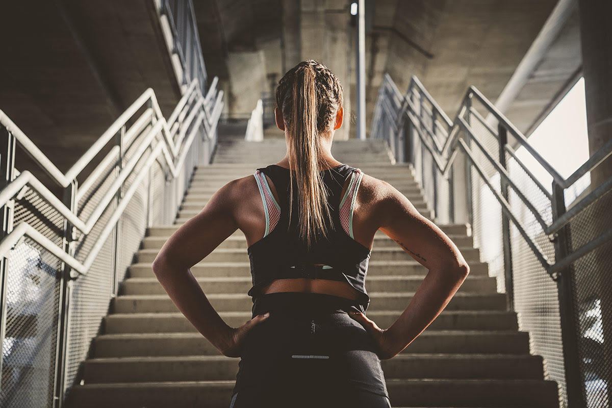 fitness woman by stairs Candice Cunningham