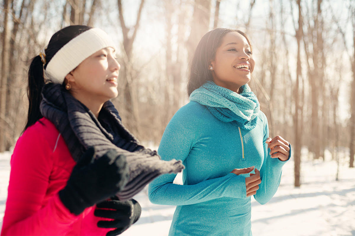 Two women cold weather running outside