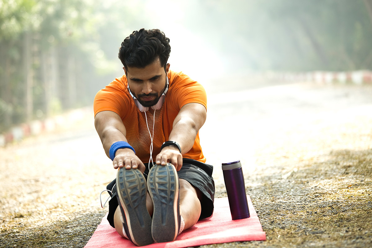man practices yoga with a knee injury