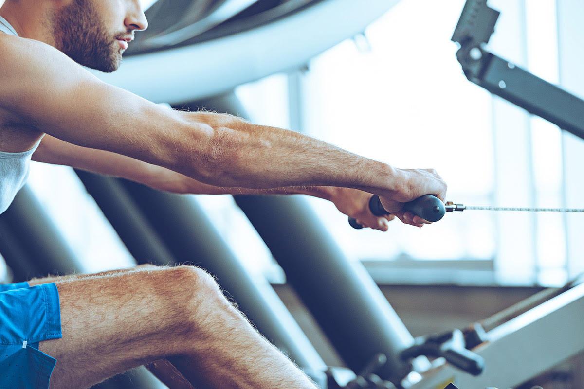 man gets cardio benefits of rowing