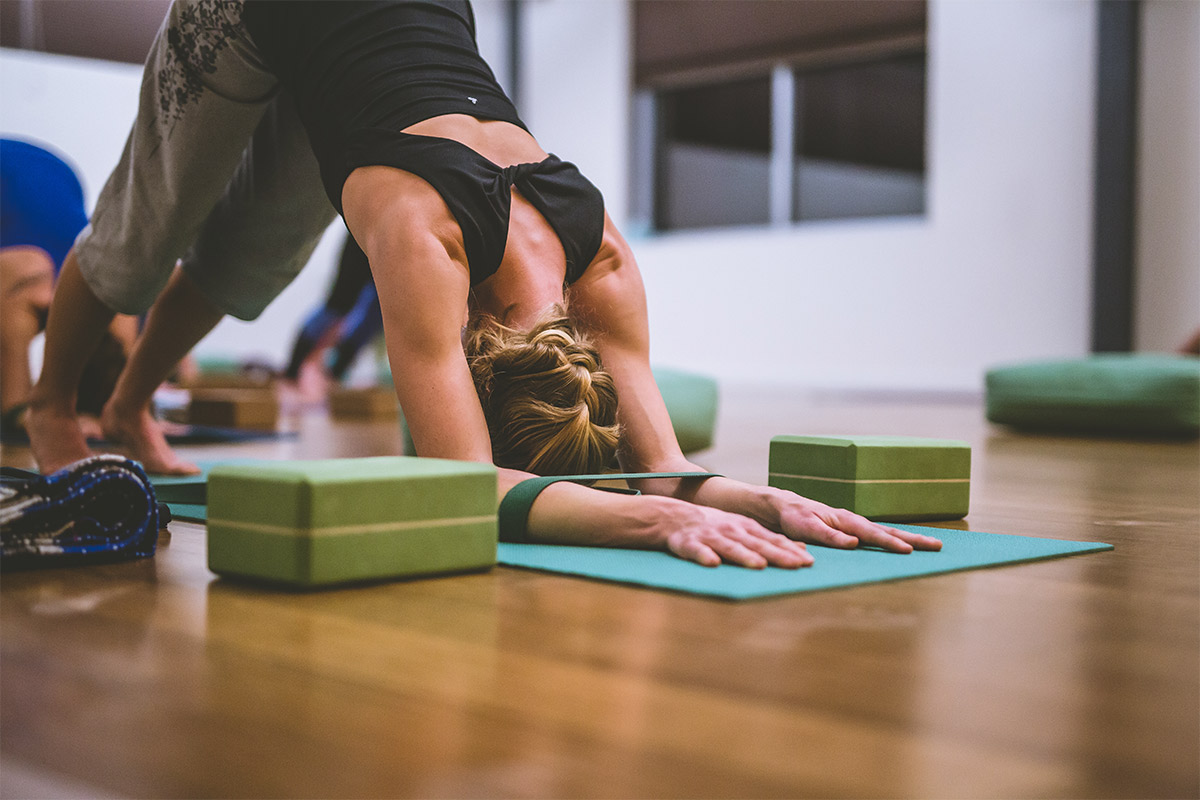 woman uses yoga props