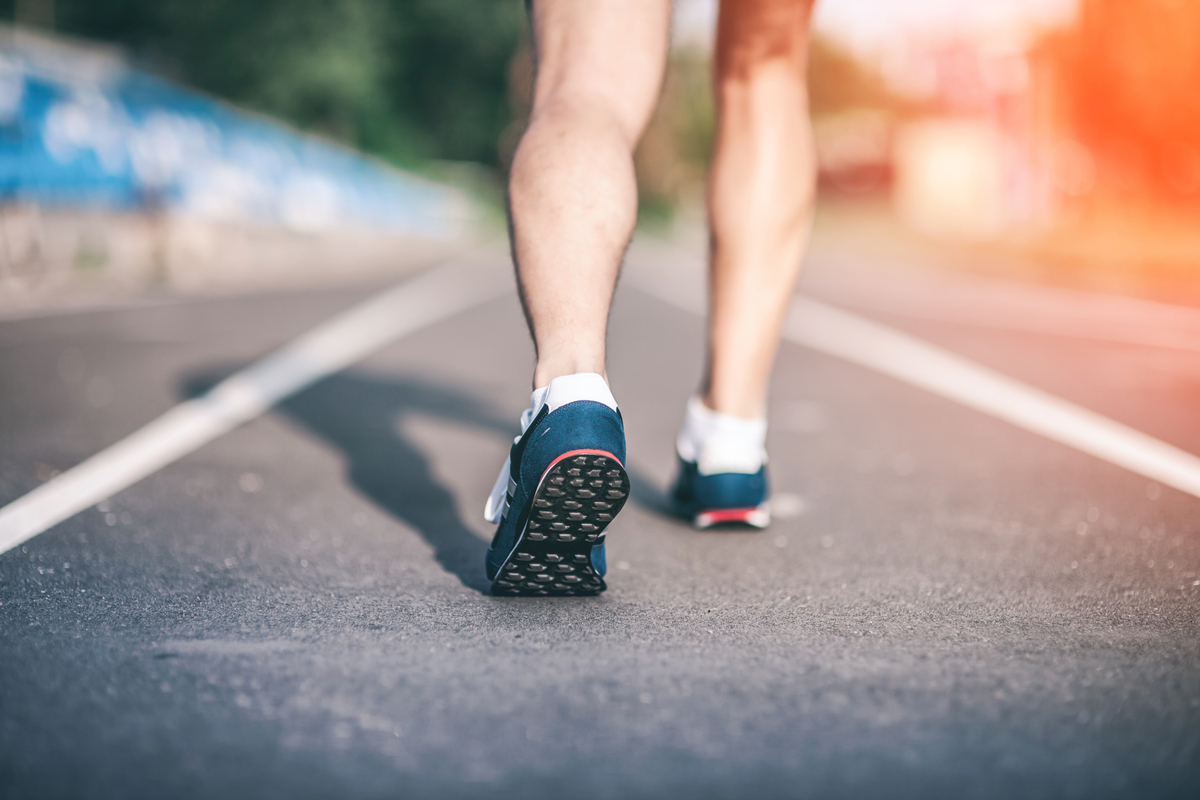 man runs in soft running shoes