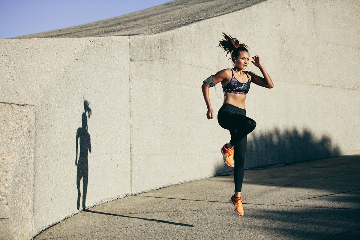 woman does HIIT exercise to improve pace