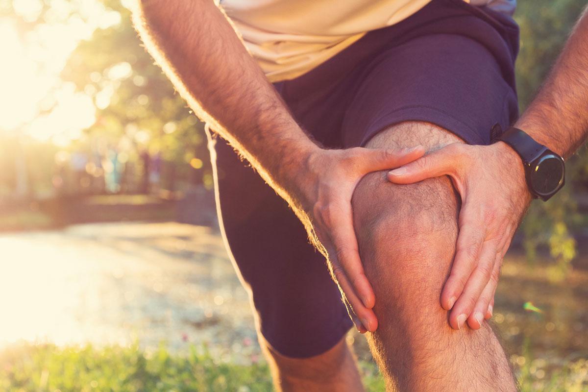 man massages osteoarthritis