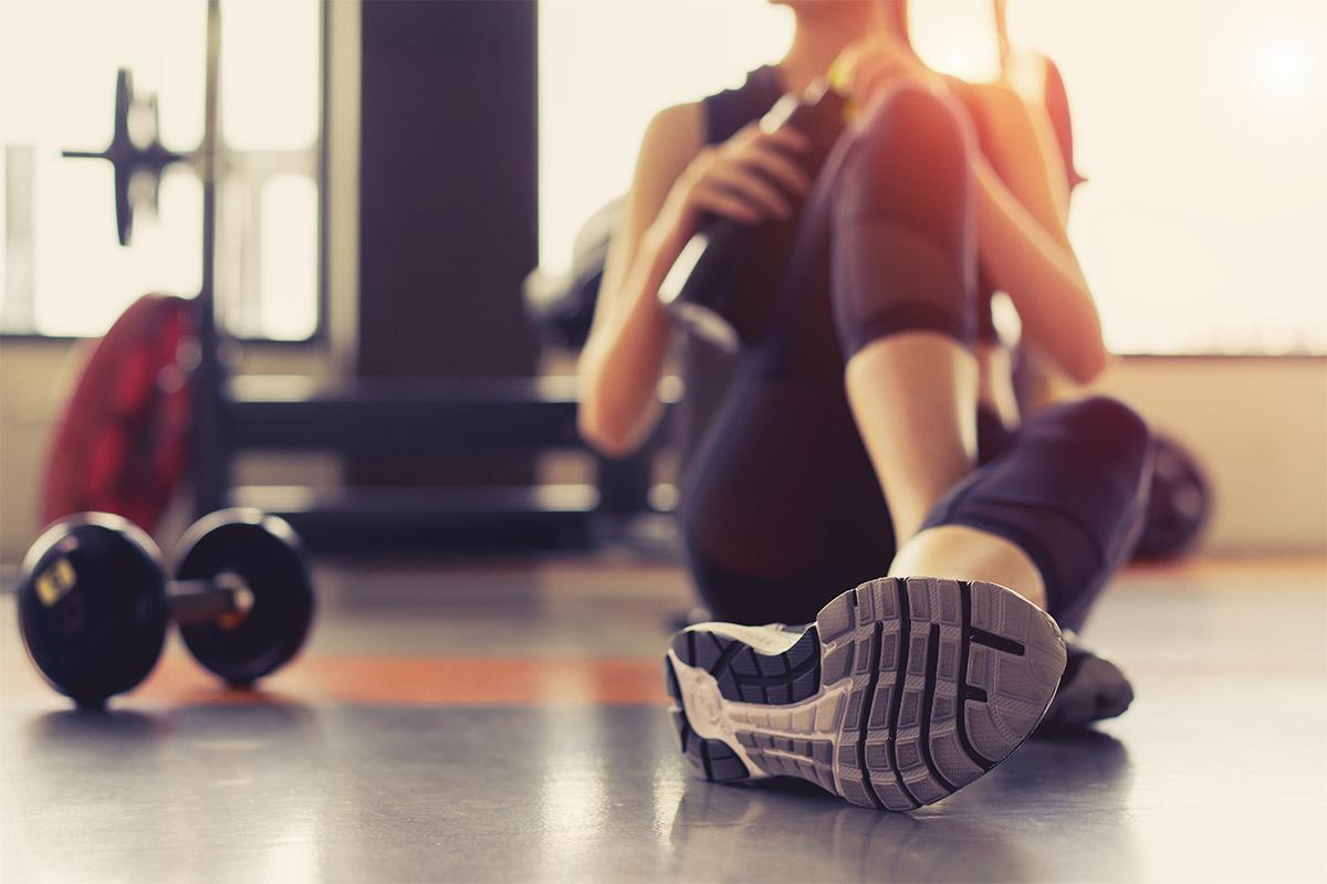 girl strength trains on vegan diet