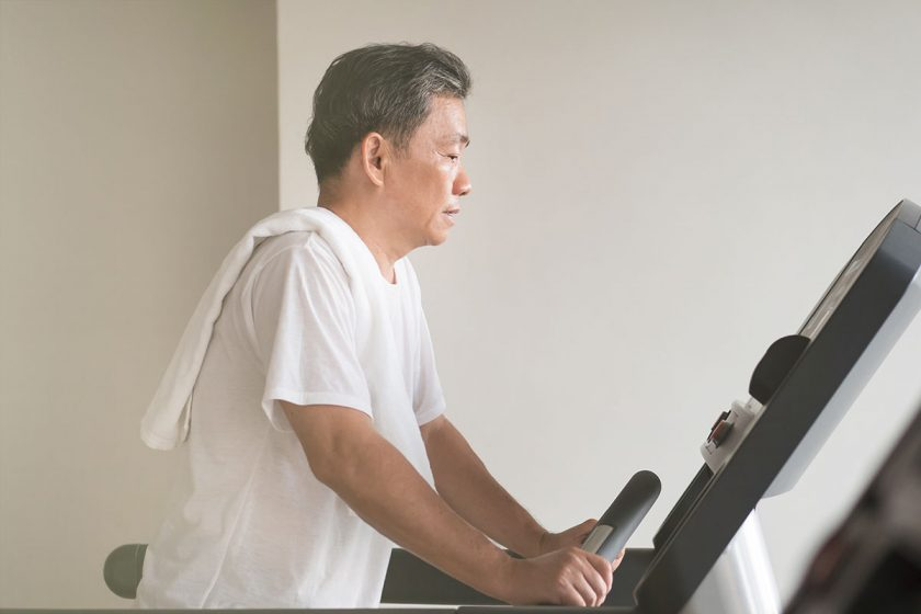 man with Parkinson's disease works out