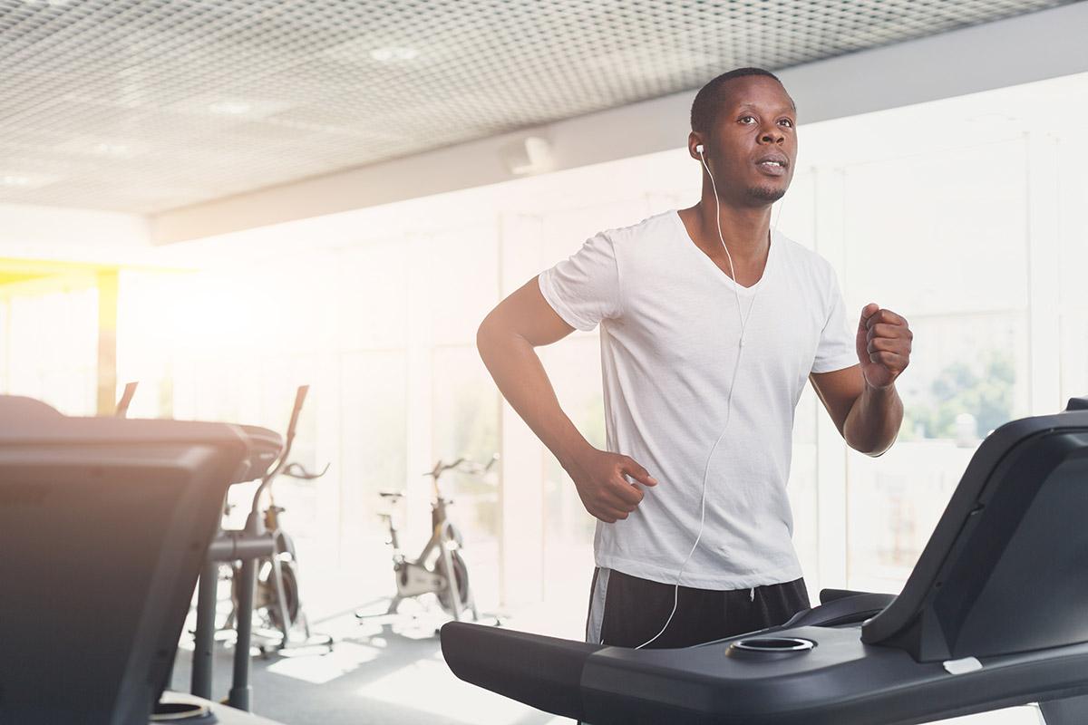 man runs outdoor running and treadmill running