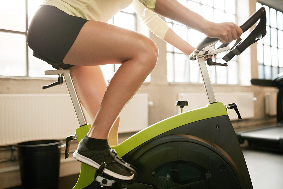 woman on indoor cycling bike