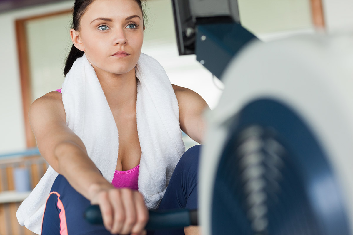 woman gets benefits of the rowing machine