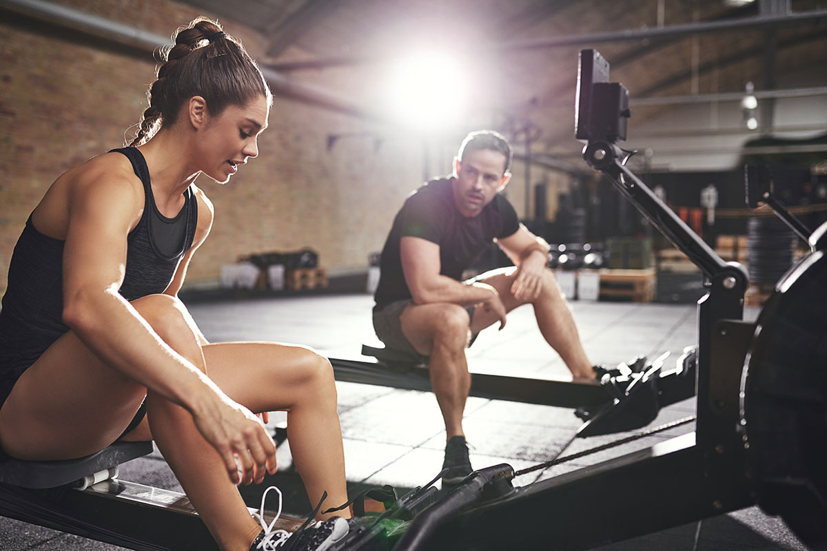 couple shows how to strengthen your core with rowing