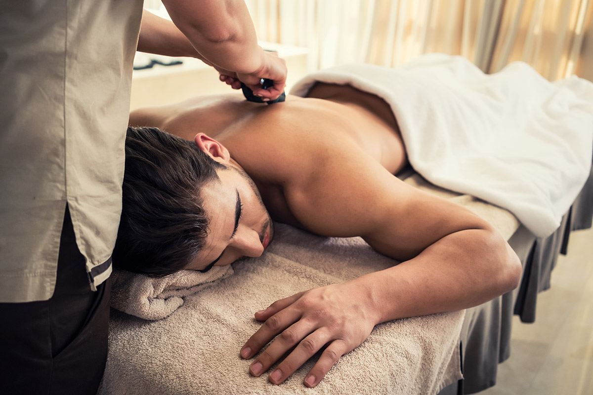 man with trigger points getting massage