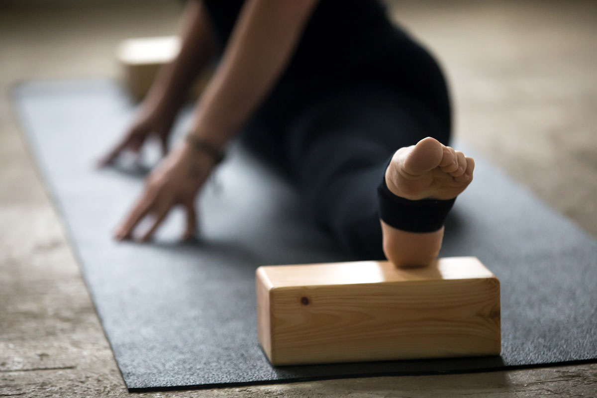 woman uses yoga blocks
