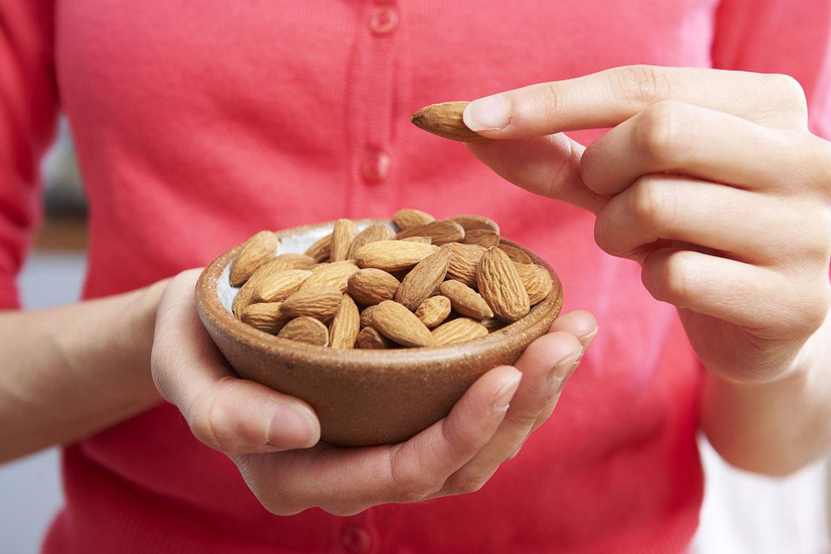 woman follows snacking tips