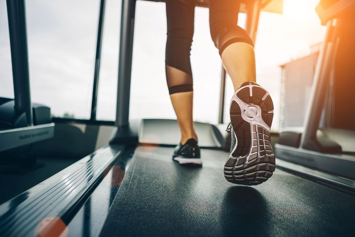 woman runs long distance on a treadmill