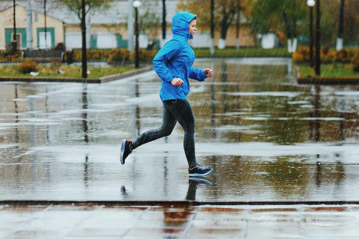 woman goes running in the rain