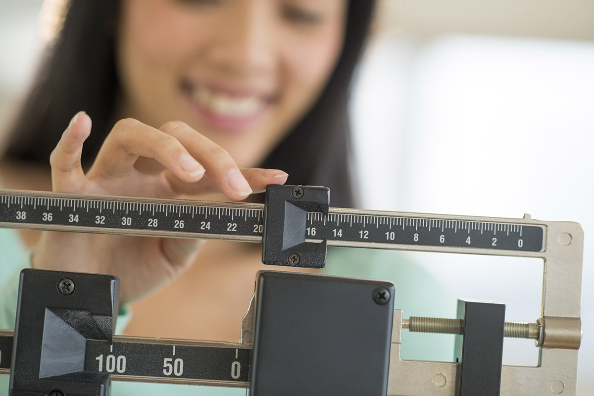 woman contemplates weighing yourself every day
