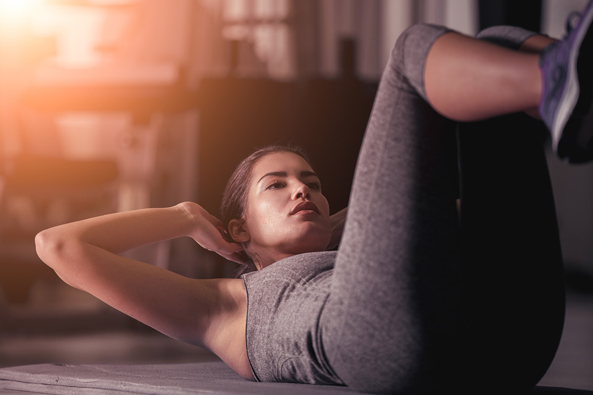 woman has neck pain during ab workouts