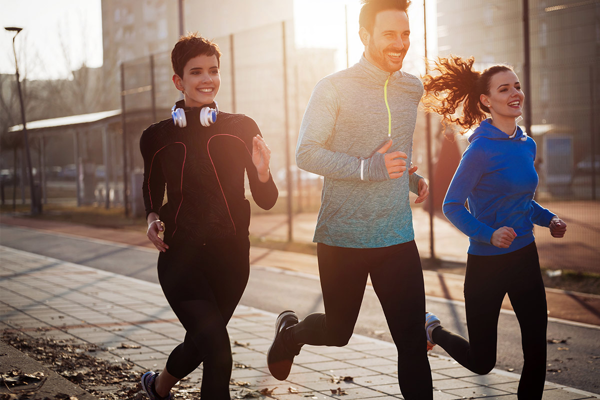 group running outdoors in a crowded city