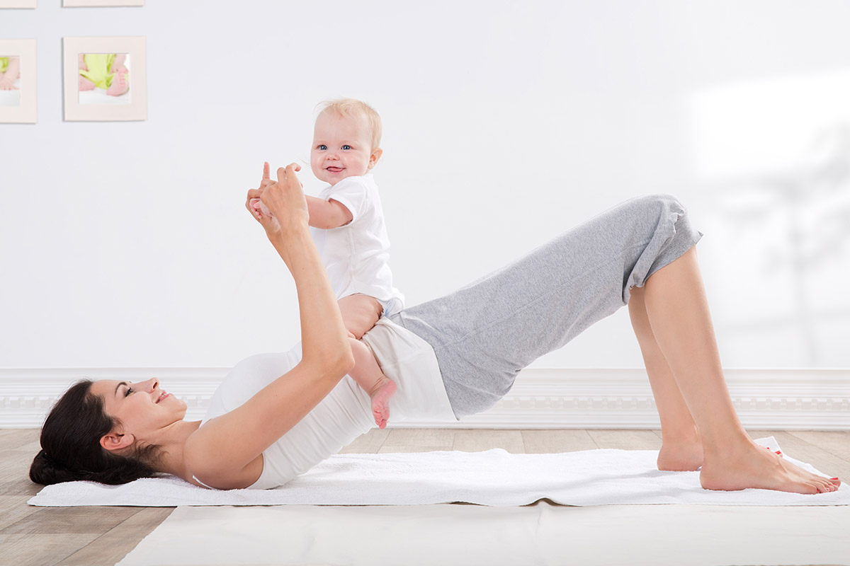 woman does postpartum pelvic exercises